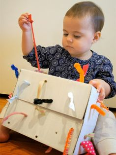 "This ""tugging box"" upcycles cardboard and fabric scraps into something guaranteed to keep little ones busy."