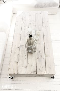White washed recycled pallet table and Moroccan themed decoration.