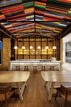 Standing Out From the Crowd: Yabu Pushelberg's Thai Approach at Siwilai. Painted steel roofing forms the café's canopy