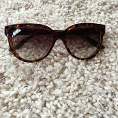 Marc By Marc Jacobs sunglasses Torturous color have some scratches on lens. Have been worn couple times Marc by Marc Jacobs Other