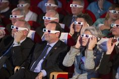 French National Centre for Space Studies president Jean-Yves Le Gall, French President Francois Hollande, and former French astronaut Claudie Haignere wear 3D glasses during a visit at the Cite des Sciences at La Villette in Paris as they follow the successful landing of the Philae lander on comet 67P/ Churyumov-Gerasimenko, November 12, 2014. REUTERS