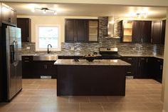 Completely updated kitchen with added island. #AndrewCordle