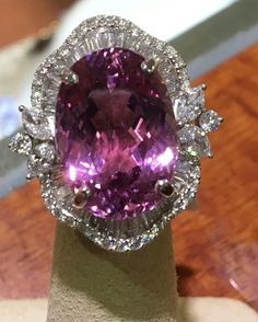 @beckersdiamonds. Feast your eyes on this oval #kunzite surrounded by 2.19ctw of round, #baguette, and #marquise diamonds.