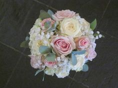 Handtied bouquet of roses with gypsophila and eucalyptus