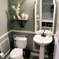 Little Bit of Paint remodeled their bathroom on a tight budget. It looks like a completely new room! The paint color is Valspar Wet Cement. Love how it looks with the wainscoting. Thanks Therena! See more Valspar paint colors and gray paint colors. #valsparwetcement