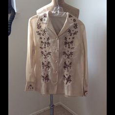 Vintage Embroidered Blouse Vintage embroidered blouse.  Light weight. Embroidery in excellent condition.  Very cute for a western look with a suede fringed jacket.  Size not tagged calling it a small. Vintage Tops Button Down Shirts