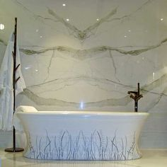 Luxury Bathroom With Freestanding Bath Featuring Porcel Thin Calacatta Marble Book Matched Porcelain Tiles