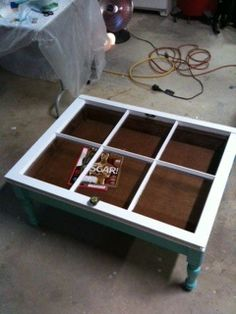 Shadow box coffee table made with old window.