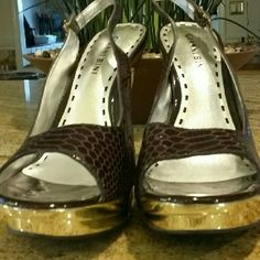 """NWOT - Gianni Bini Shoes NWOT - Beautiful gold metallic heels (5"""") and gold platform section of shoe. The remaining shoe is brown leather in an alligator style pattern. Giani Bernini Shoes Heels"""