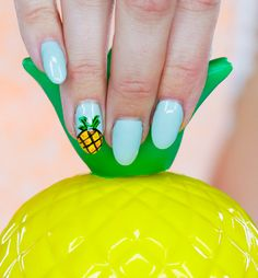 If you like pina coladas, you'll love this nail art. (We do!)