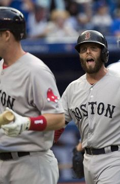 Boston Red Sox second baseman Dustin Pedroia, right, reacts to his teammate Stephen Drew after he after Pedroia was tagged out at home plate against the Toronto Blue Jays during the first inning of a baseball on Thursday, Aug. 15, 2013, in Toronto. (AP Photo/The Canadian Press, Nathan Denette)