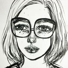 Big glasses & Messy hair.