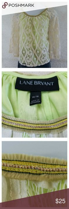 "Lane Bryant Lace Overlay Tunic Pullover scoop neck cream lace tunic with lime green bodice underlay, sheer dolman bell sleeves, embellished neckline with velvet fringe and delicate gold beadwork.  Slightly flowing style sure to be as comfortable as it is stylish.  Excellent condition.  Shell 62/38 cotton/nylon blend, lining 100% cotton  Machine wash, cold, line dry  Sized as a 14-16 Lying flat: Bust 23"" Hip 32"" Sleeve 24"" Length 27"" Lane Bryant Tops Tunics"