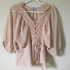 Vintage feminine top Victorian style nude feminine blouse. Flowy top with lace detail. Bell sleeve and peplum style. Boho gypsy feel. Not Free People just using for visibility Free People Tops Blouses