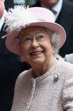 Queen Elizabeth,in a Rachel Trevor Morgan hat, visit Lloyd's of London, insurers of the royal collection
