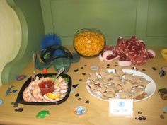 fish food buffet (goldfish crackers in fish bowl, shrimp cocktail, & starfish sandwiches)