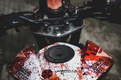 Your love for art, motorcycles, and Resident Evil series will reach the next level when you will carefully analyze this KTM Duke 200 Zombie Edition. Duke Motorcycle, Duke Bike, Racing Stickers, Bike Stickers, Ktm Rc 200, Ktm Duke 200, Custom Sport Bikes, Yamaha Bikes, Bike Photography