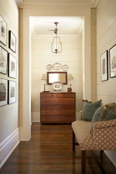 Homeward Bound   Garden and Gun - Wondering how our stairwell would look if we painted it a cream....it IS a stairwell and closed in, but this little hallway seems to handle the color well.  Maybe?  I intend to use the walls for photos . . . that will help.  These walls are cream, baseboard is white.