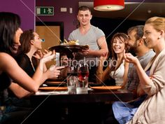 Friends socializing at a restaurant Royalty Free Stock Photo