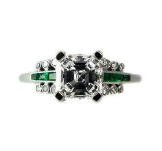Australian Art Deco Hardy Brothers diamond ring. The Asscher cut diamond is four claw set in platinum with six channel set baguette cut emeralds and twelve bezel set single cut diamonds on the shoulders on a 1.30 mm band. The ring is signed Hardy Bros. Circa 1930. This setting is all handmade.