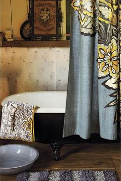 Beautiful Bathroom...love the fabric shower curtain in gray & yellow, the black tub & the wood flooring, etc.