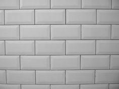 White metro tiles with grey grouting.