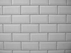 White metro tiles with grey grouting.
