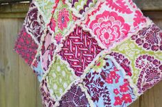 Heirloom in Sapphire, Pink and Purple and Green Rag Quilt Lovey, READY to Ship. $24.00, via Etsy. ~ Love this fabric for a rag quilt