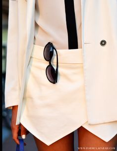 Close up of my white skorts! Check out more on www.formulafarah.com. By Formula Farah #fashion #blogger #fashionblogger #formulafarah #detail #sunnies #white #skorts