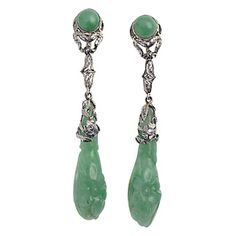 Doyle & Doyle. These carved jade and diamond drop earrings are mini works of art, $3,900, from Doyle & Doyle.