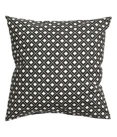 CONSCIOUS. Cushion cover in woven organic cotton fabric with a printed pattern, solid-color backing, and concealed zip. Size 20 x 20 in.