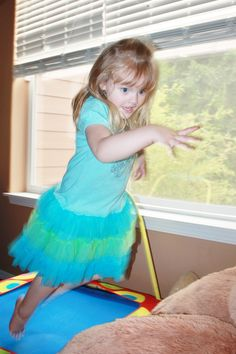 Isabella, age 4, bouncing around indoors. Submitted by Melanie L. -- Choose your favorite photo and submit your vote by August 6, 2012 for a chance to win a gift card for children's books!