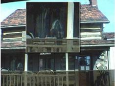 This picture was taken in February 2002 of what used to be a local general store. It appears the building has attracted some shoppers from the other realm  as well