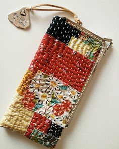{inspiring} - kantha or sashiko or running stitch embroidery ideas, pretty patchwork zipper pouch with leather tassleThe Beauty of Japanese Embroidery - Embroidery Patterns Sashiko Embroidery, Japanese Embroidery, Embroidery Stitches, Hand Embroidery, Embroidery Designs, Boro Stitching, Kantha Stitch, Japanese Textiles, Running Stitch