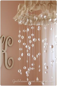 DIY crystal nursery mobile, or chandellier for daughter's room. Love it. I would love to do this! My mom loved crystals and it would be like she had a part in something even though she isn't here