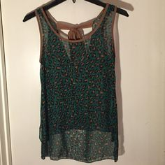 Sheer Leopard tank. Adorable sheer green and brown leopard tank with brown ribbon back. Pair this with a beige tank underneath and some blue jeans and you got yourself a perfect day into night outfit. Edge Tops Tank Tops