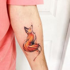 Lovely fox watercolor tattoo.
