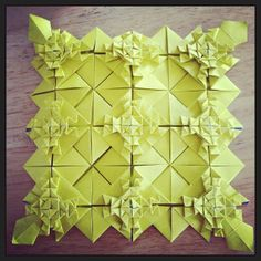 Origami tesselation.  Designed by Anna Kastlunger. Folded by me. One of the first times that I have ever done a tessellation and I really liked the way this one turned out. My wife put it in a frame so we can show it off in our future household.