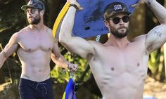 Chris Hemsworth showcases his muscular build shirtless at the beach