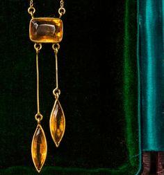 I love asymmetry.1900s Art Nouveau Citrine Pendant Necklace, 18K Gold