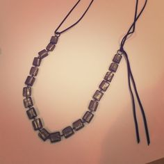Long Club Monaco Stone and Suede Necklace Clear pearlescent silver stones inlaid with dark brown suede make a very stunning and long necklace, that can be made shorter by retying the suede string shorter. Amazing piece, comes in two colors! Club Monaco Jewelry Necklaces