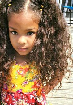 Beautiful baby girl with long wavy hair