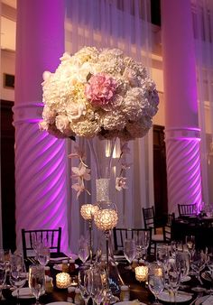 Elegant centerpiece with purple spot lighting
