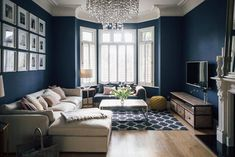 Leoma's Awe Inspiring London Home Dark Blue Sitting Room With Shutters And Glass Chandelier - Victorian Villa Sitting Room Painted In Farrow & Ball Stifkey Blue