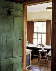 i love clawfoot tubs... love the old green door, too :)