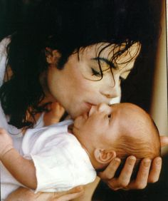 Michael Jackson with one of his beautiful babies king of pop always remember R.I.P love on and only mj