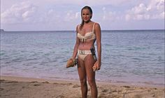 Ursula Andress in her most famous pose in Dr. No.