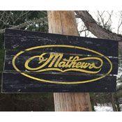 Mathews Archery Wooden sign.