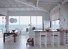 Beach house, mainly white, many windows, will fill the home with light and a crisp fresh breeze