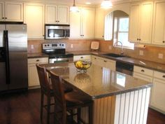 Beautiful Glazed & Beadboard Cabinets, Our kitchen remodel consists of custom lighting (dimmer, undercabinet lighting, can lighting), tiled granite countertops, off-white shaker style cabinets with glaze, beadboard, and valance over the window. We added extra electrical outlets, extended cabinets to the ceiling, and added a pantry., Kitchens Design